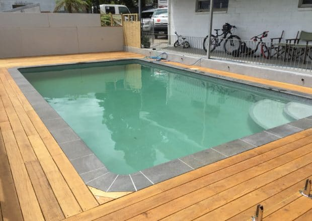 Residential pool after renovation and new deck