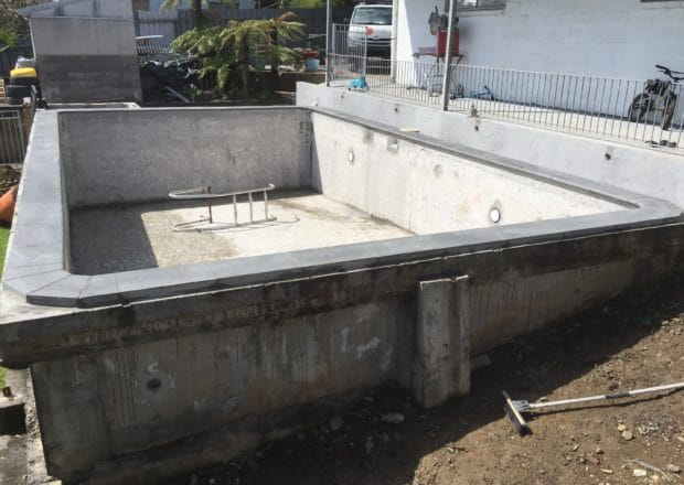 Residential pool before renovation and deck surrounds