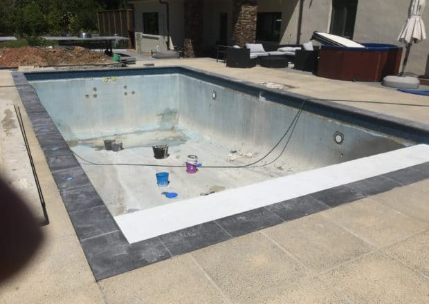 Home pool before renovation with new platform